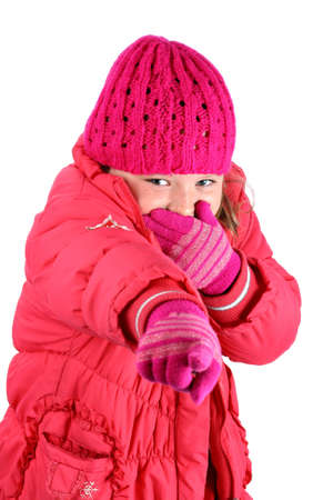 Small girl in red winter clothes laughing pointing her finger at camera isolated on white photo