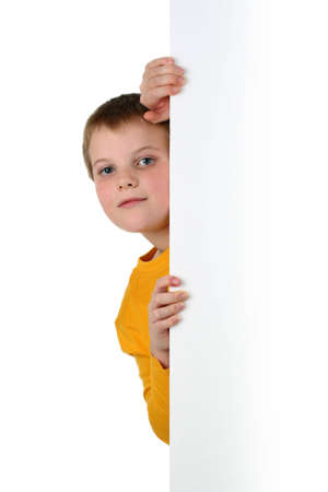 room for text: Small boy looks out of blank billboard isolated on white