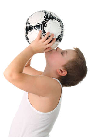above head: Small boy kissing the football ball isolated on white