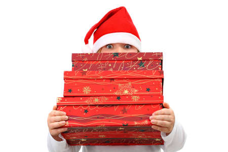 Small girl in Santas red hat carrying three presents isolated on white photo