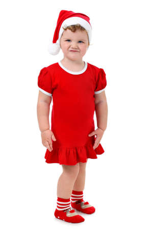 the whole body: Baby girl in Santas hat and red dress isolated on white