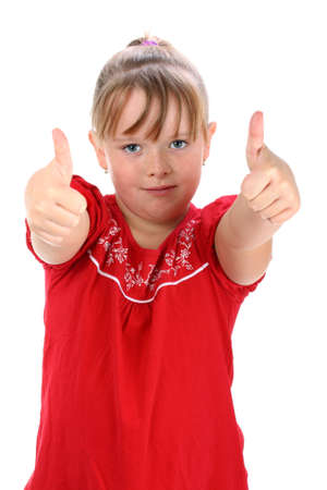 Small girl showing thumbs up gesture isolated on white photo