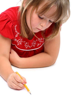 pre schooler: Small girl drawing something with a pencil isolated on white