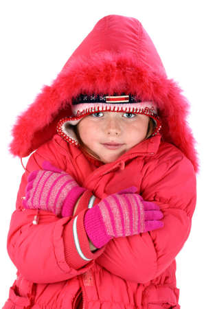 Small girl in red winter clothes embracing herself isolated on white photo