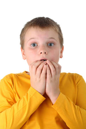 room for text: Worried 10 year old boy with his fingers in his mouth isolated on white Stock Photo