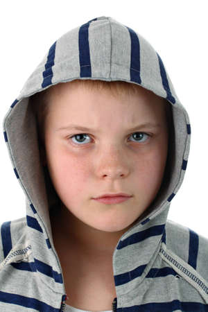 frowned: Frowned young boy in sportswear with gray hood isolated on white Stock Photo