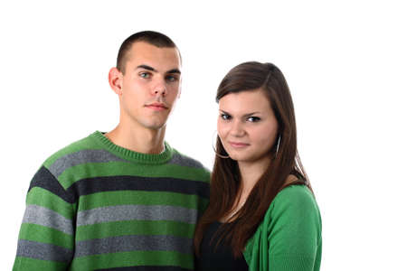 Young couple in green clothes isolated on white photo