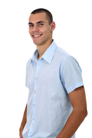 Handsome smiling young man in blue shirt isolated on white photo