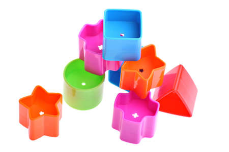 Various coloured blocks for shape sorter toy isolated on white. Copy space and room for text available photo