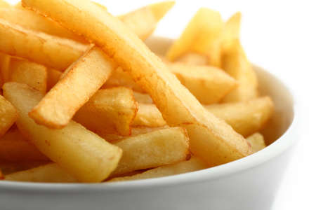 french cuisine: French fries detail isolated on white