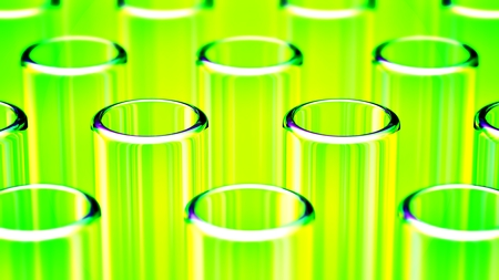 Close up on rows of glass test tubes, with green reflections
