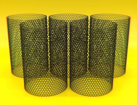 Close-up of five nanotubes of graphene on yellow background