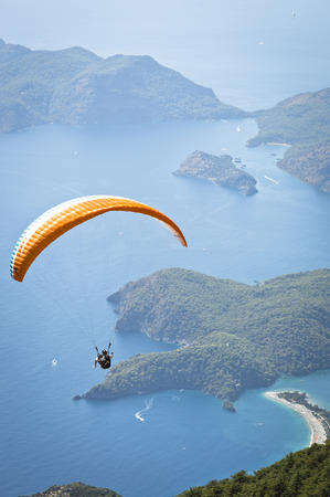 Fethiye, Turkey - September 6, 2013: Paragliding at Fethiye Oludeniz. Paragliding is a free flying sport where the pilot launches themselves by foot.