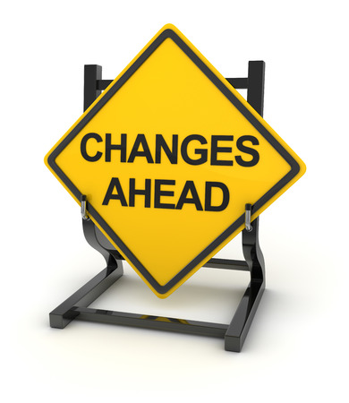 Road sign writing on changes ahead Stock Photo