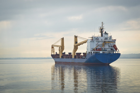 blue sea: Cargo Ship at Sea