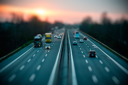 Traffic on highway , tilt shift effected photo.