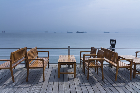 Wooden seat in empty beach cafe , horizontal photo.