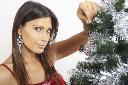 Woman decorating Christmas tree photo