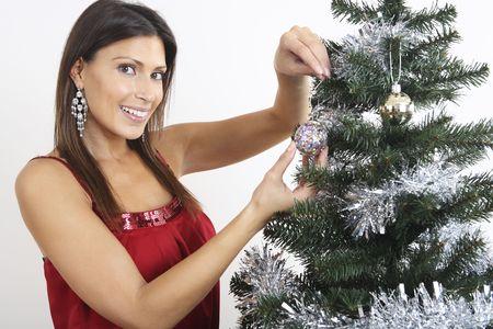Woman decorating Christmas tree Stock Photo - 2219997