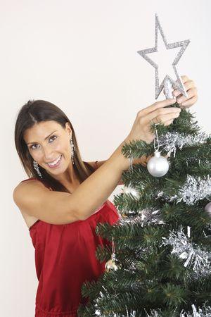 decorating christmas tree: Woman decorating Christmas tree