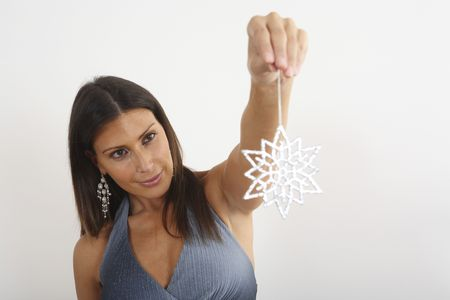 Woman holding a decorative Christmas snowflake Stock Photo - 2219551