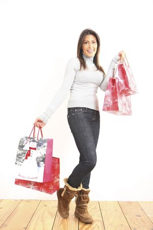 Woman holding Christmas shopping bags photo