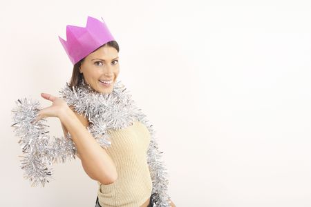 Woman with pink party crown silver tinsel wrapped around her
