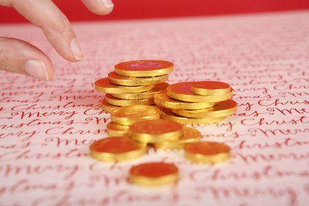 gelt: Hand taking chocolate Hanukah gelt, gold coins
