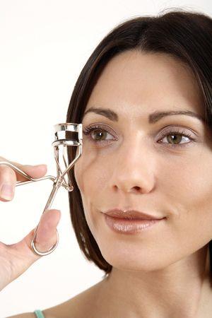 curler: Woman using eyelash curler