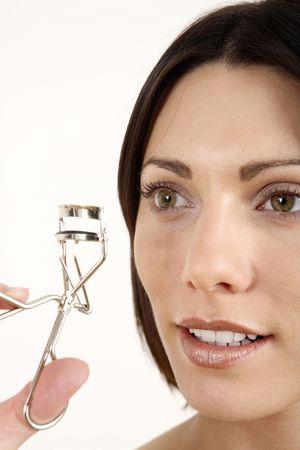 curler: Woman holding eyelash curler