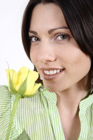 Woman with yellow rose smiling at the camera Stock Photo - 2966119
