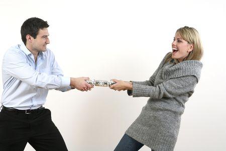 Man and woman pulling christmas cracker photo
