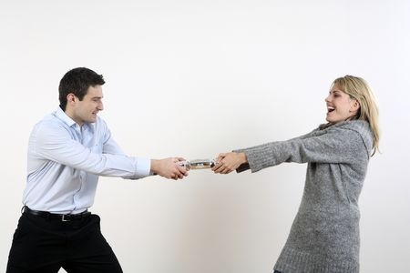 Man and woman pulling christmas cracker Stock Photo - 2966222