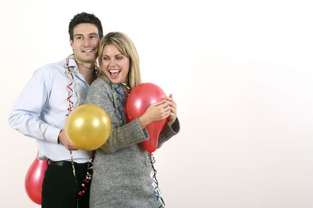 Man and woman with streamers and balloons Stock Photo - 2966226