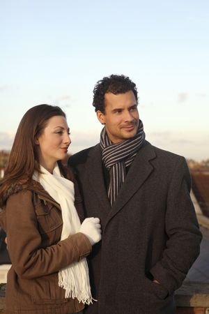 healthy llifestyle: Man and woman in winter clothing at the rooftop