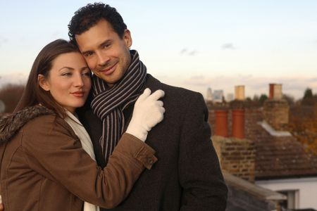 Man and woman in winter clothing hugging at the rooftop Stock Photo - 2966230