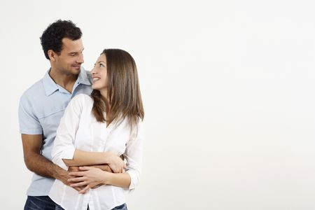 healthy llifestyle: Man hugging woman from behind LANG_EVOIMAGES