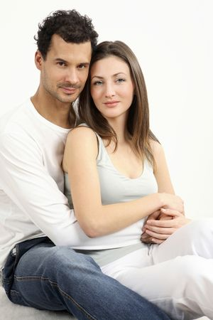 healthy llifestyle: Man hugging woman from behind, both sitting down LANG_EVOIMAGES