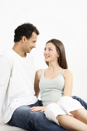 Woman and man sitting down, staring at each other Stock Photo - 2966251