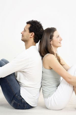 healthy llifestyle: Man and woman sitting down, leaning back to back LANG_EVOIMAGES