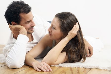healthy llifestyle: Man and woman lying sideways, looking at each other LANG_EVOIMAGES