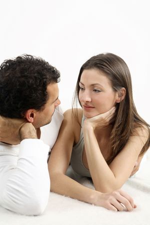 Man and woman lying forward, looking at each other Stock Photo - 2966255
