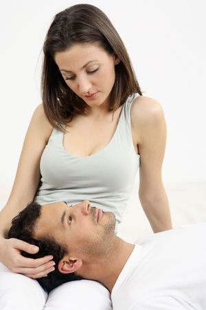 Woman looking at man who is lying on her lap Stock Photo - 2966257