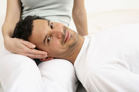 healthy llifestyle: Man lying on womans lap, smiling at the camera