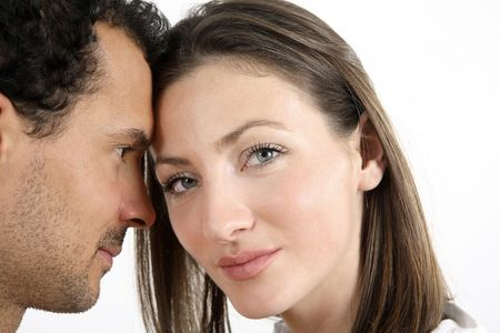 healthy llifestyle: Man and womans head together, woman looking at the camera