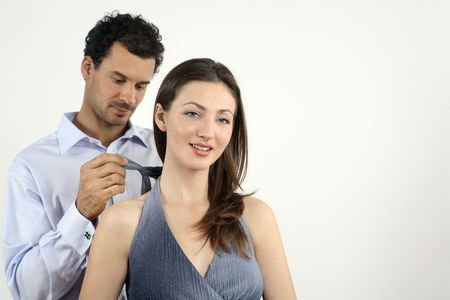 healthy llifestyle: Man helping woman to tie her dress LANG_EVOIMAGES