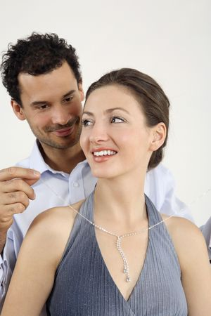 Man putting on a necklace for his girlfriend Stock Photo - 2966272