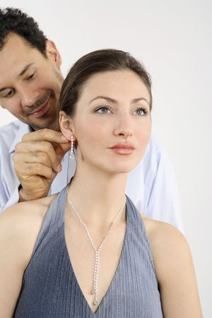 Man putting on an earing for his girlfriend Stock Photo - 2966275