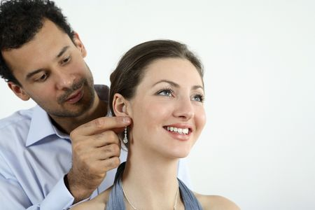 Man putting on an earing for his girlfriend Stock Photo - 2966276