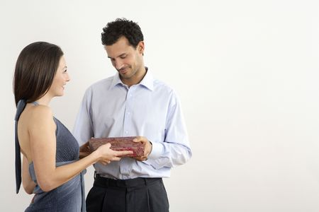 healthy llifestyle: Woman giving man a present LANG_EVOIMAGES